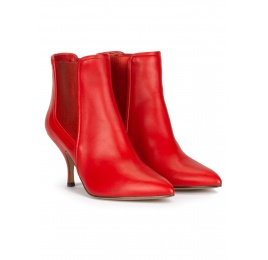 Curved heel point-toe ankle boots in red leather with elastic Pura López