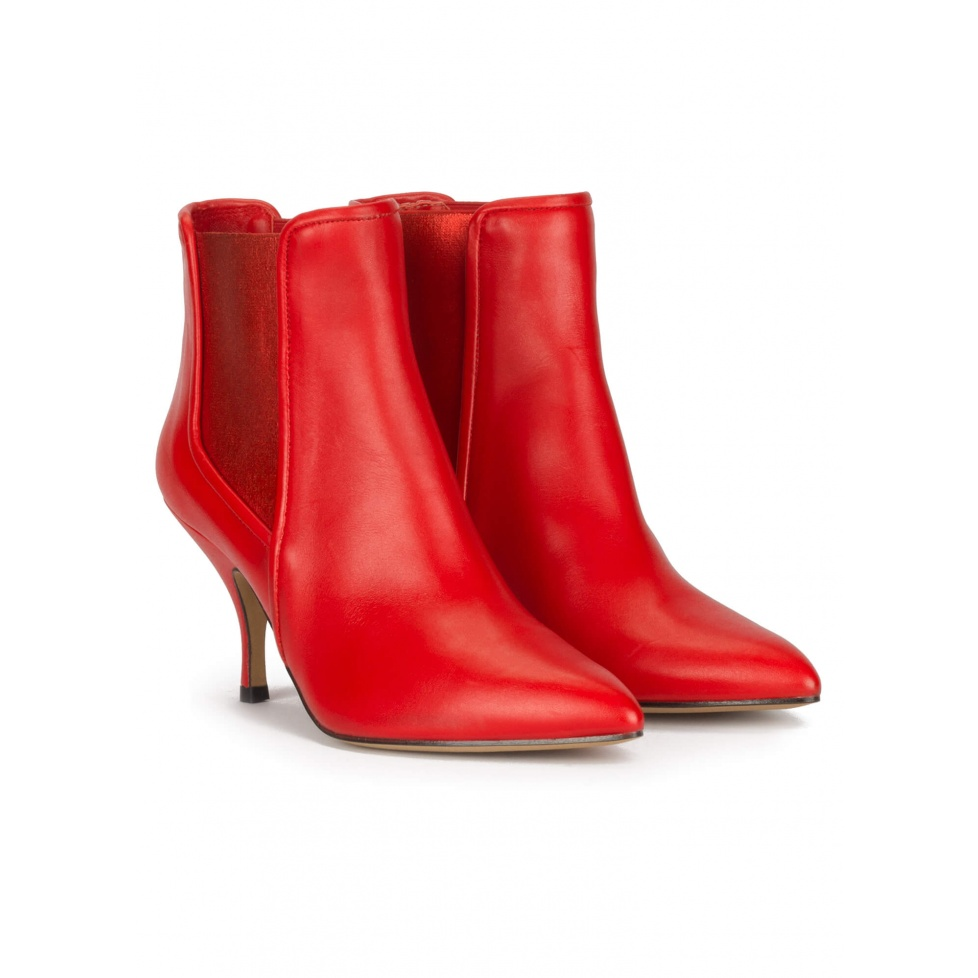 Curved heel point-toe ankle boots in red leather