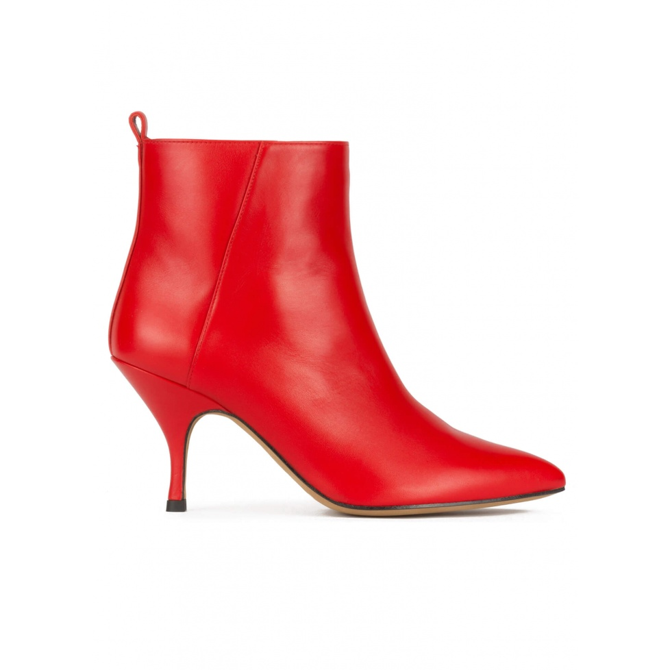Curved heel pointy toe ankle boots in red leather