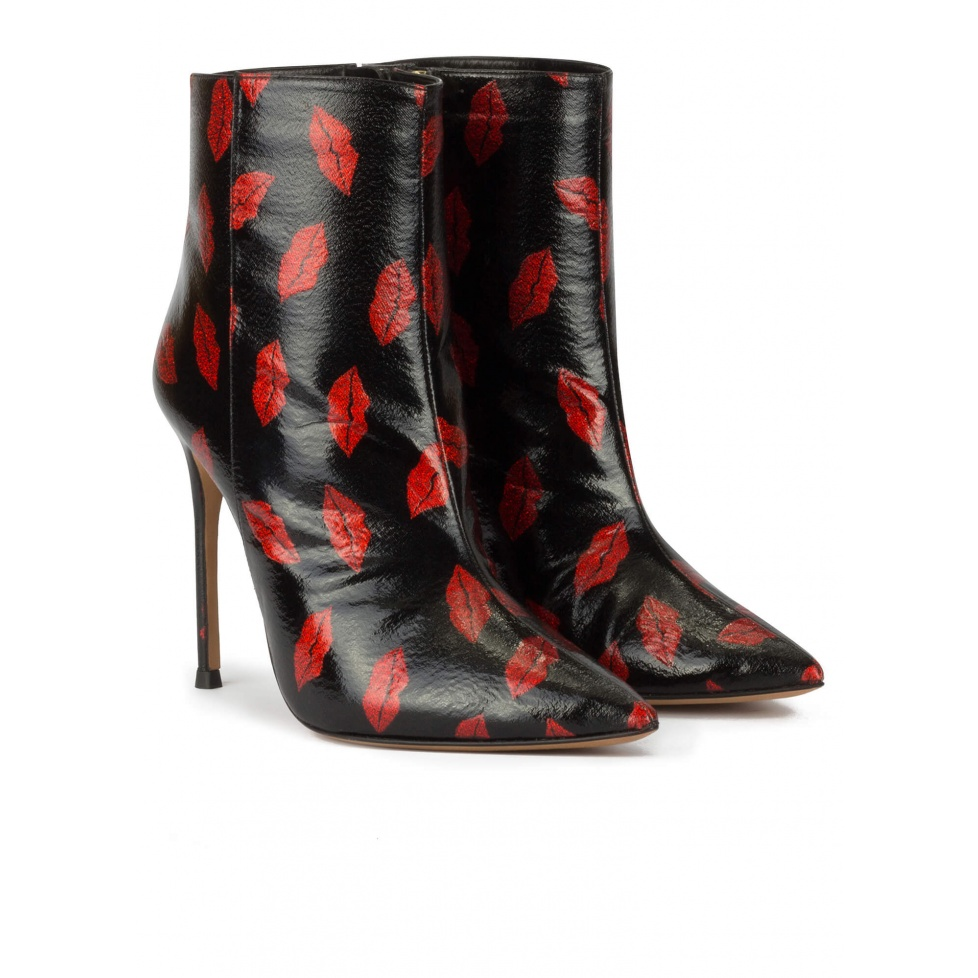 Black point-toe stiletto heel ankle boots with red kisses
