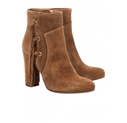 High heel ankle boots in brown suede with fringes Pura López