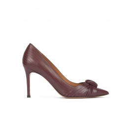 Knot-embellished high heel pumps in burgundy leather Pura López