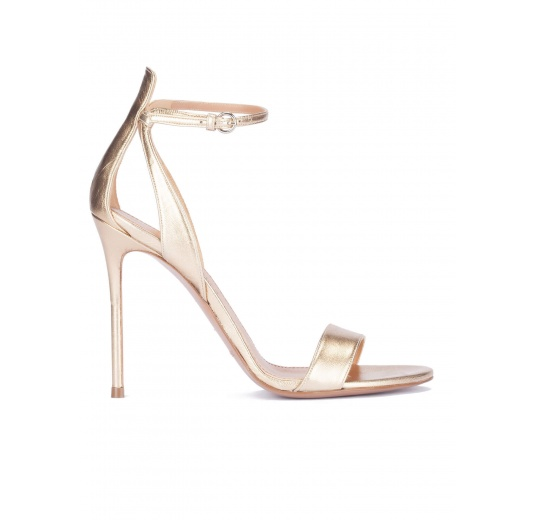 Ankle strap high heel sandals in light gold metallic leather Pura L�pez