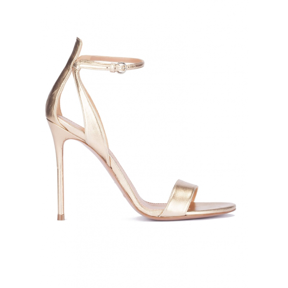 Ankle strap high heel sandals in light gold metallic leather