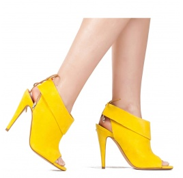 Lace-up high heel sandals in yellow suede Pura López