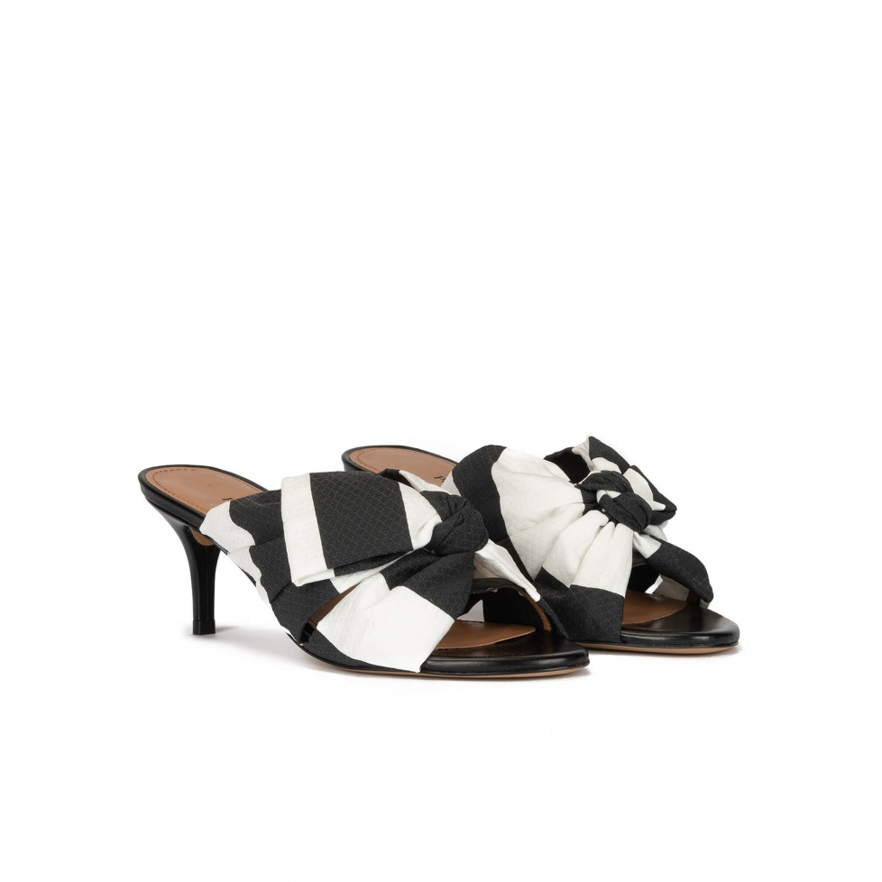 Bow detailed mid heel mules in black and white fabric