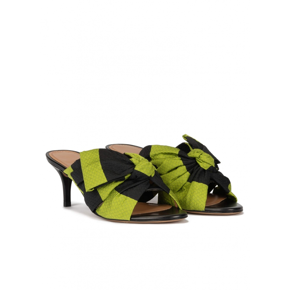 Bow detailed mid heel mules in green and black fabric