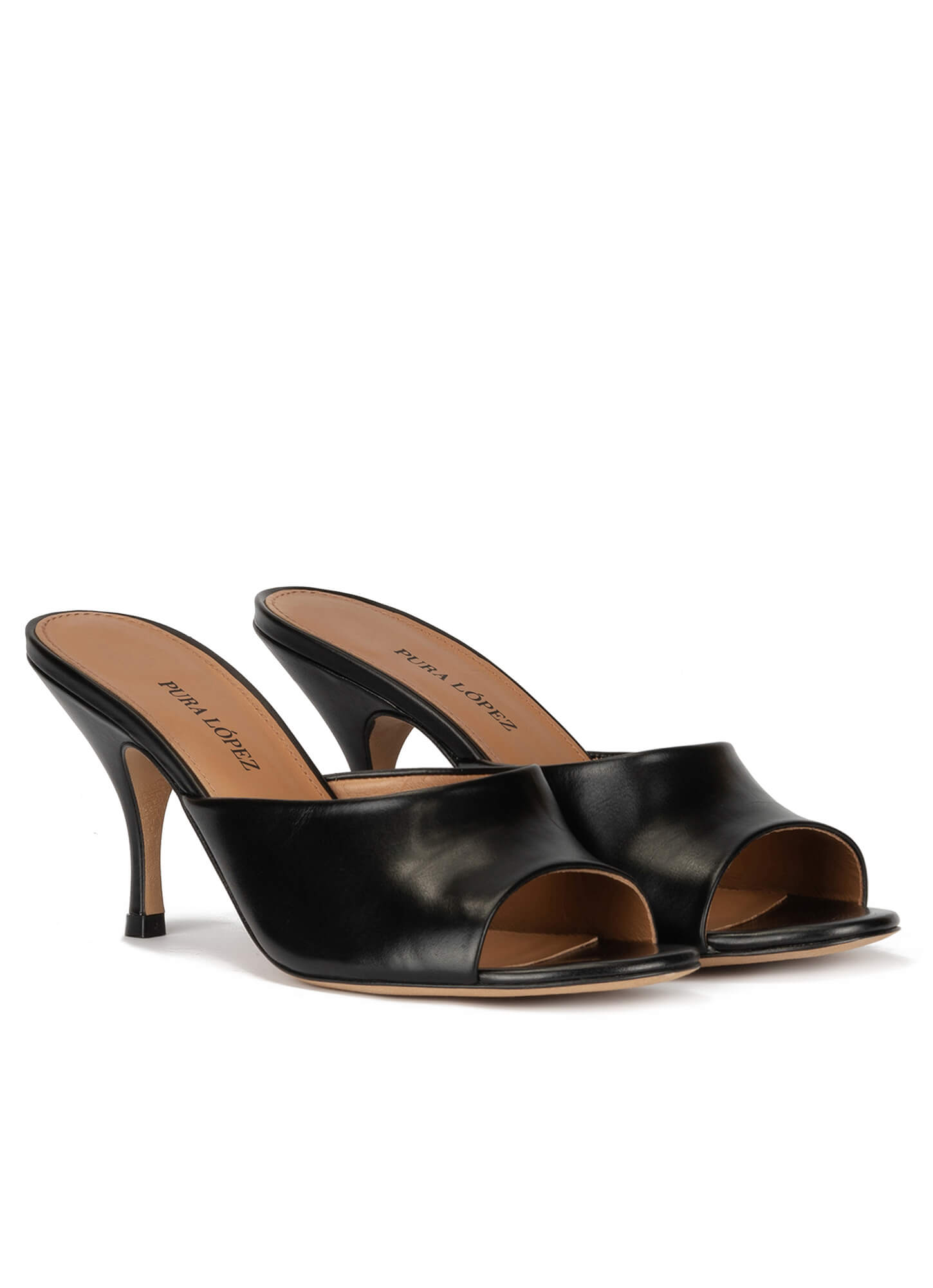 Mid heel mules in black leather . PURA