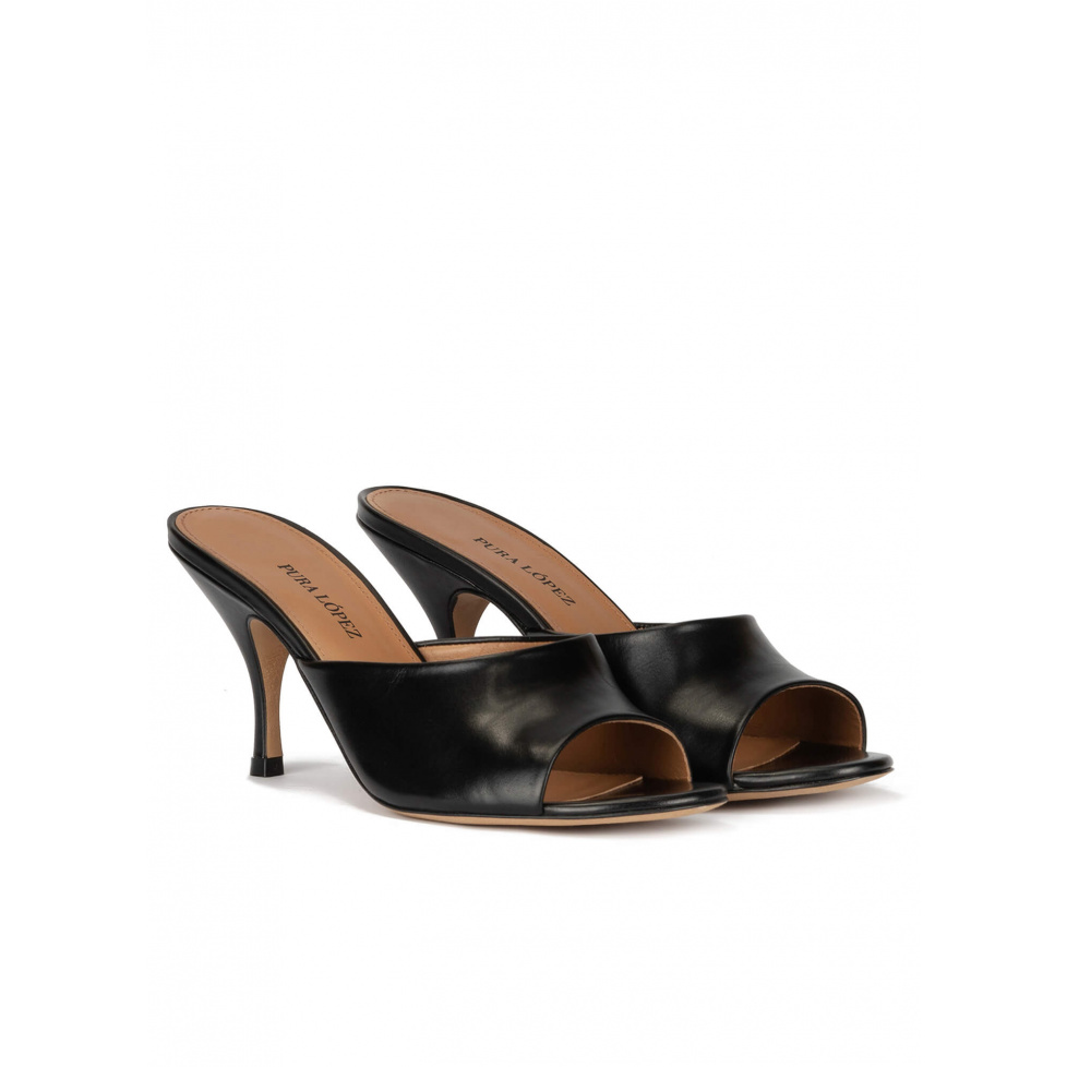 Mid heel mules in black leather