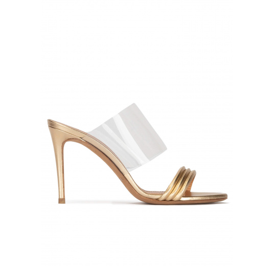 High heel mules in gold leather and transparent vinyl Pura López