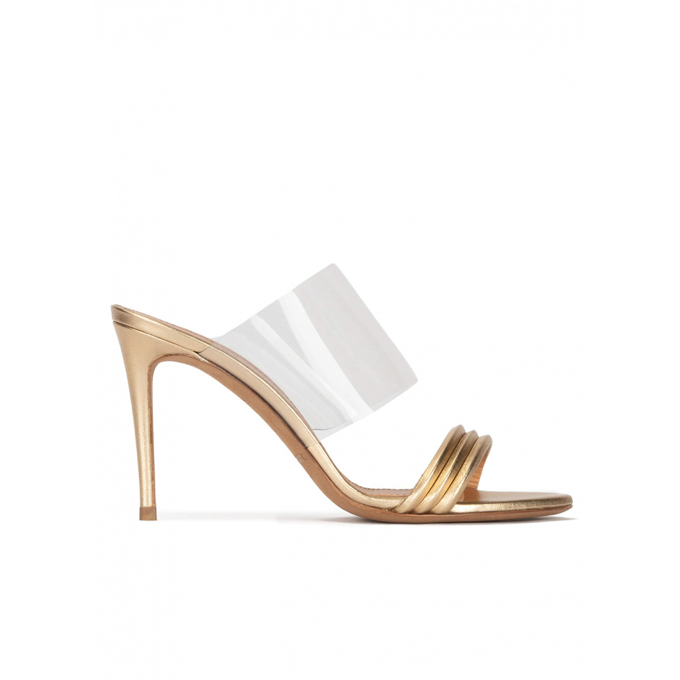 High heel mules in gold leather and transparent vinyl