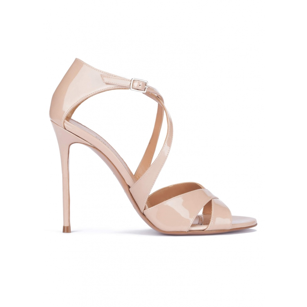 Strappy heeled sandals in nude patent leather