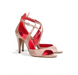 Strappy high heel sandals in nude patent leather Pura López