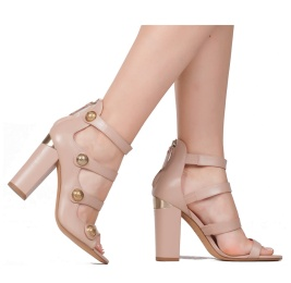 High block heel sandals in nude leather with metallic buttons Pura López