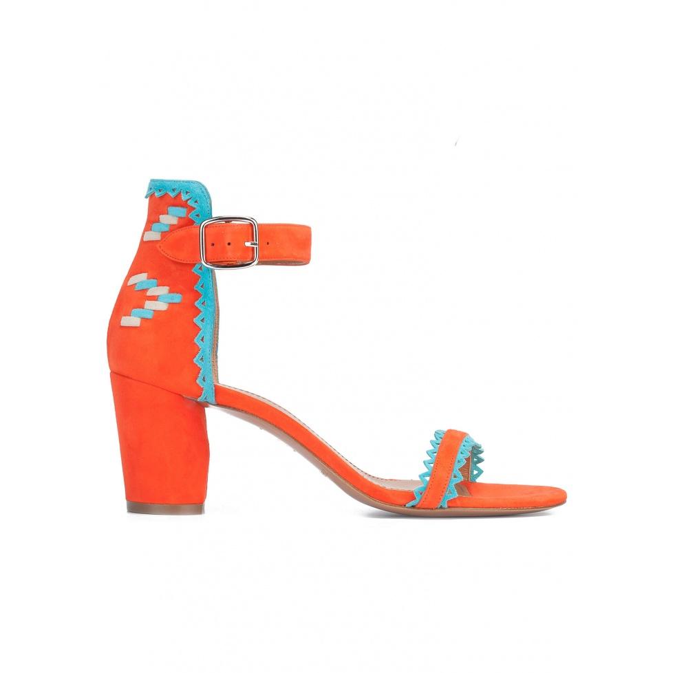 Orange block heel sandals with tribal detail at back