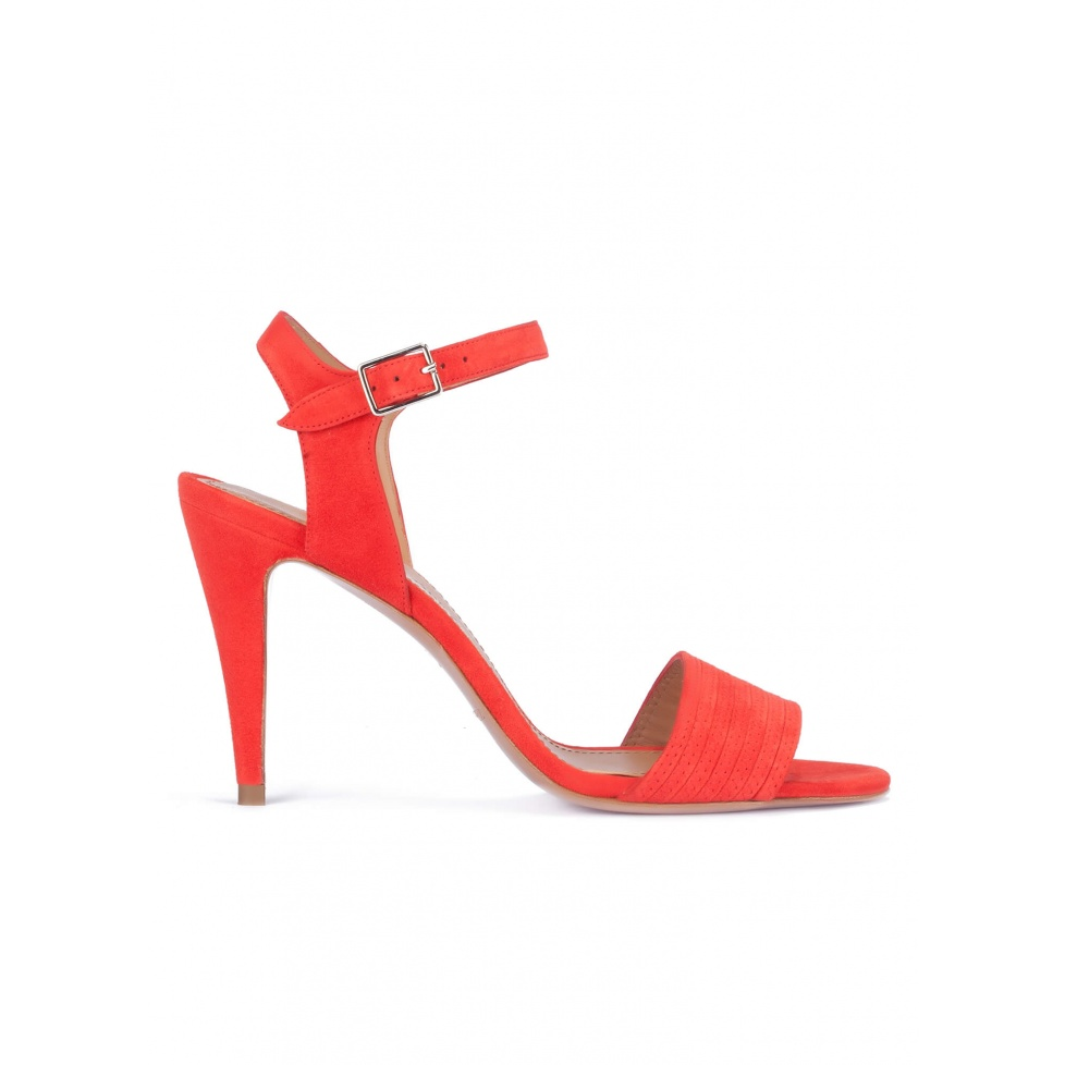 Heeled sandals in red suede