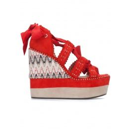 Red high wedge sandals with printed wedge Pura López