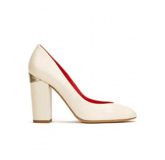 High block heel pumps in cream leather Pura L�pez