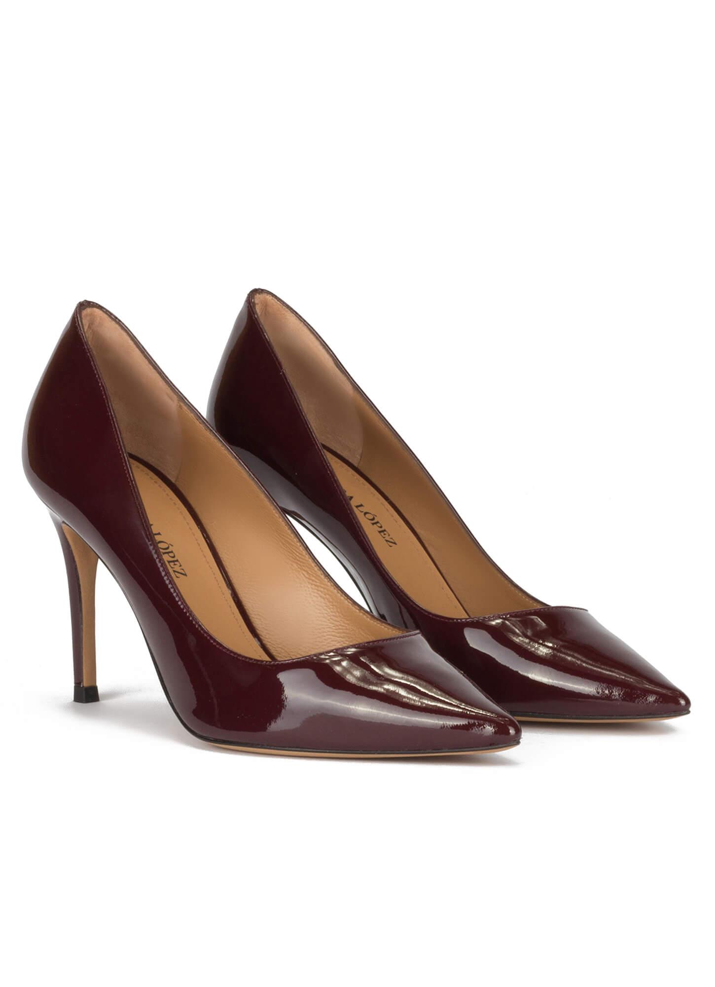 7cafcf360 Stiletto heel point-toe pumps in burgundy patent leather · Olga Pura López.  prev. next