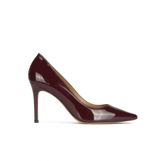 Stiletto heel point-toe pumps in burgundy patent leather Pura López