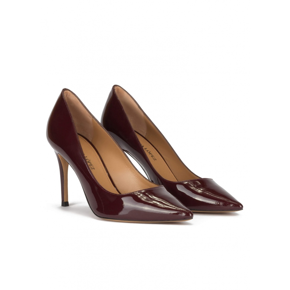 Stiletto heel point-toe pumps in burgundy patent leather