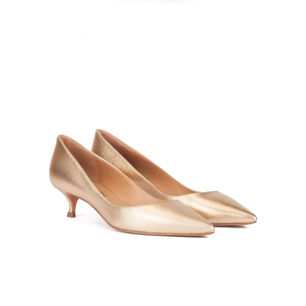 Mid heel pointy toe pumps in gold leather