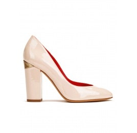 High block heel pumps in light nude patent leather Pura López
