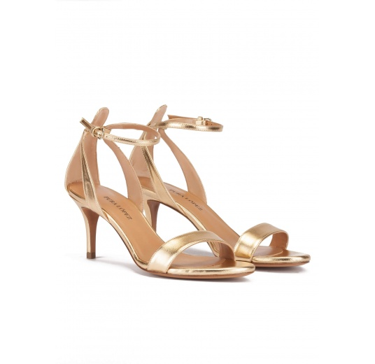 Ankle strap mid stiletto heel sandals in gold metallic leather Pura L�pez