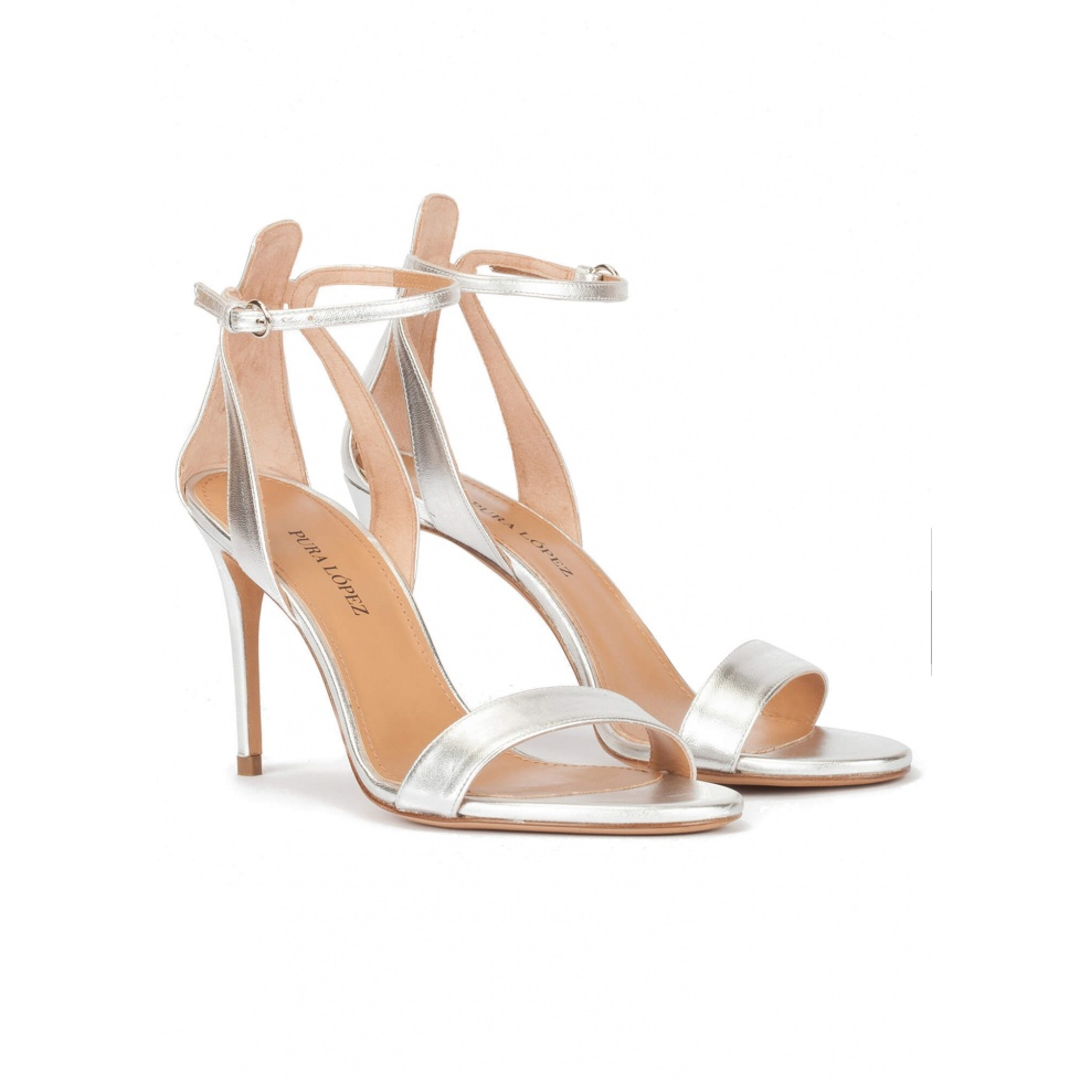 Silver ankle strap high heel sandal with minimialist design