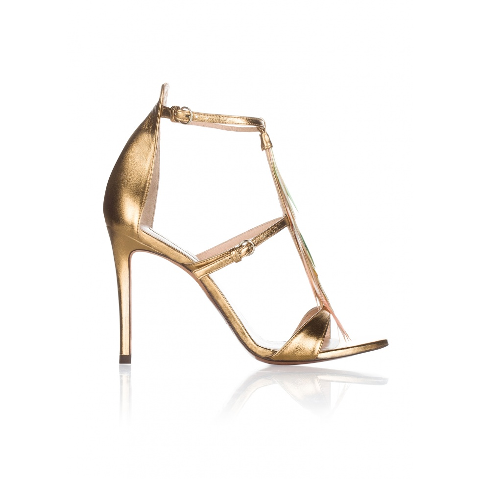 Feather detailed high heel sandals in gold metallic leather