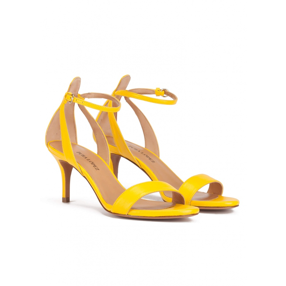 Ankle strap mid heeled sandals in yellow leather