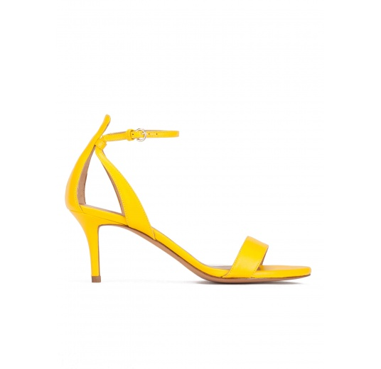 Ankle strap mid heeled sandals in yellow leather Pura L�pez