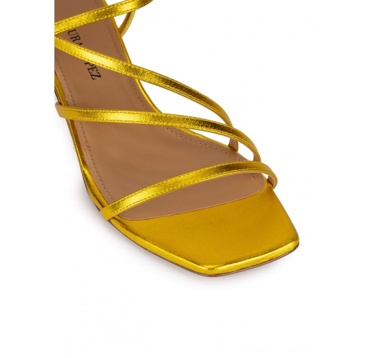 Yellow strappy mid heel sandals in metallic leather Pura López