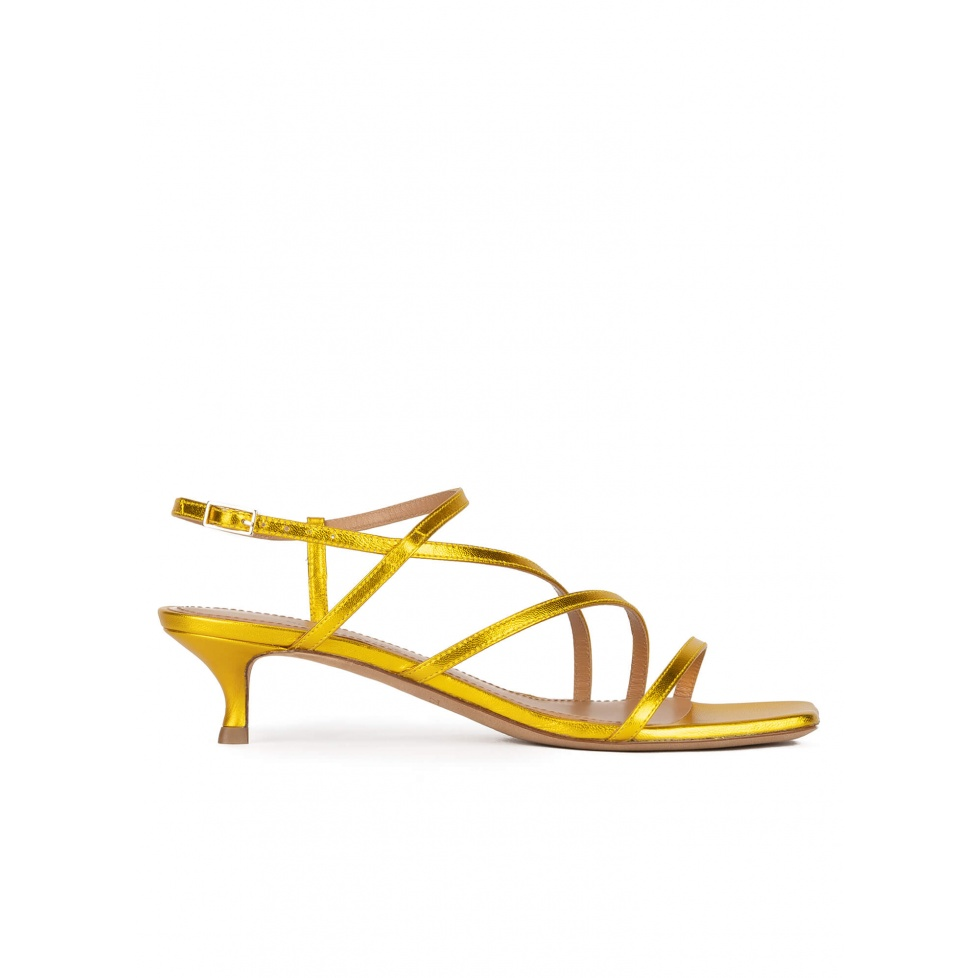Yellow strappy mid heel sandals in metallic leather
