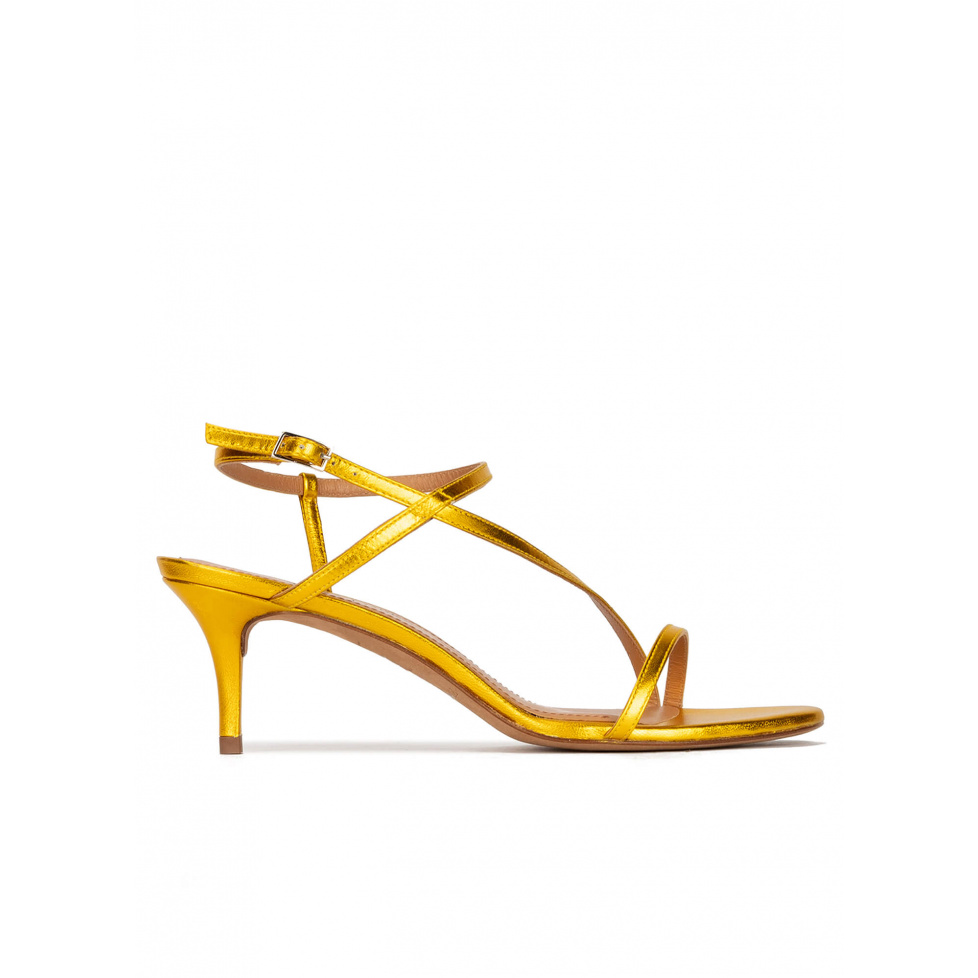 Strappy mid-heeled sandals in yellow metallic leather