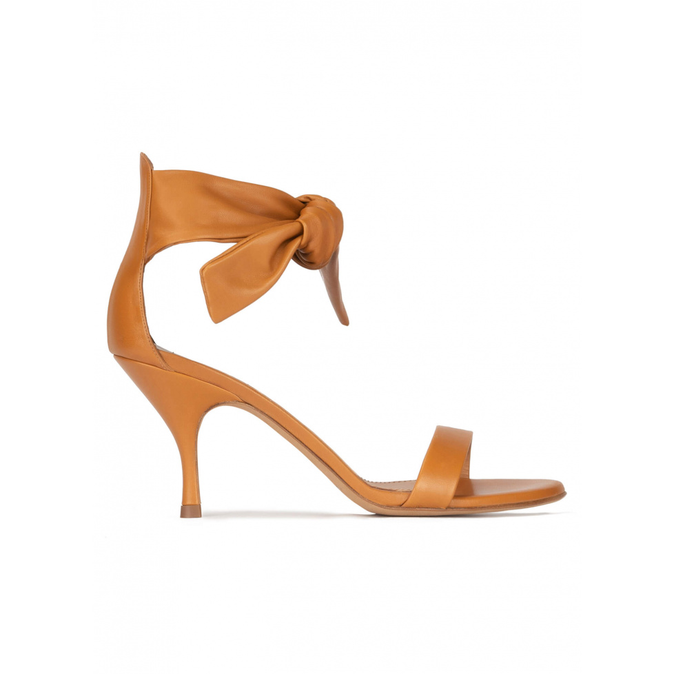 Mid heel sandals in camel leather with knotted ankle strap