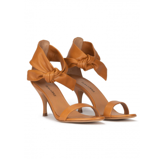 Mid heel sandals in camel leather with knotted ankle strap Pura López