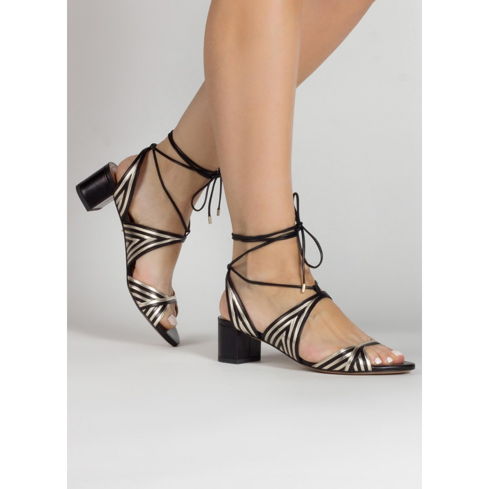 Strappy mid block heel sandals in gold an black leather