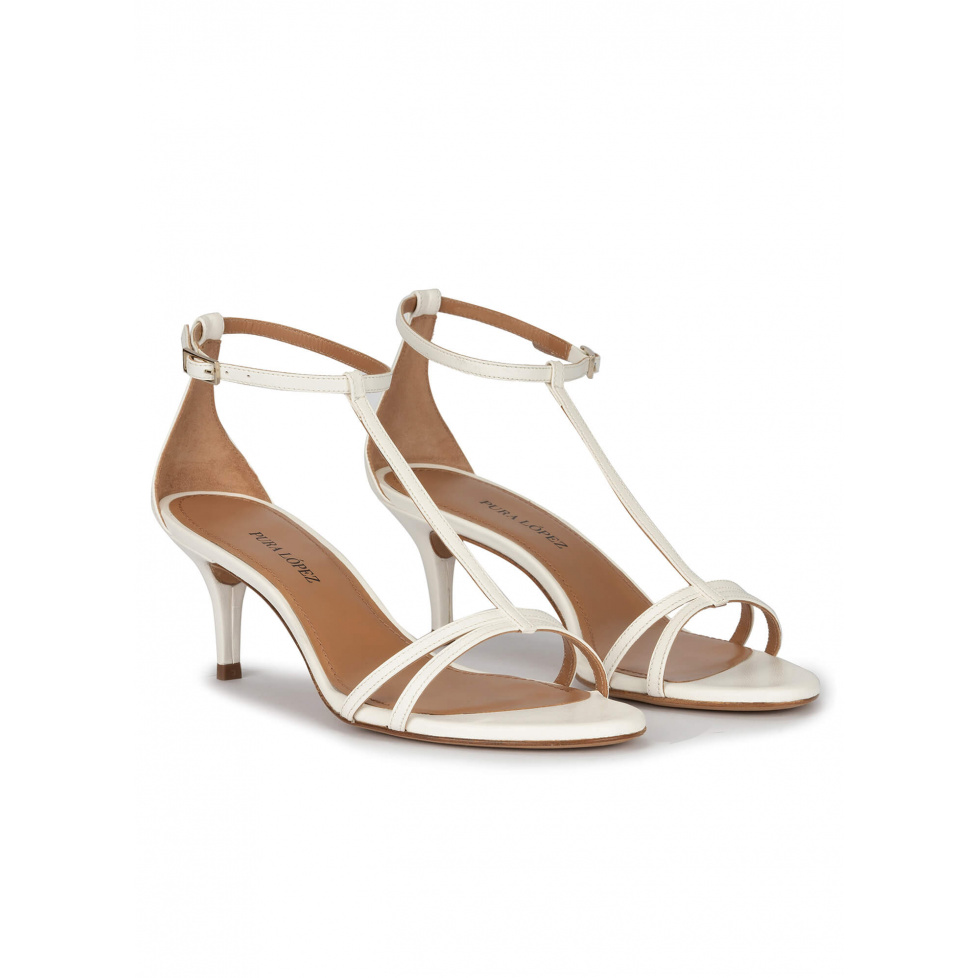 Ankle strap mid heel sandals in off-white leather