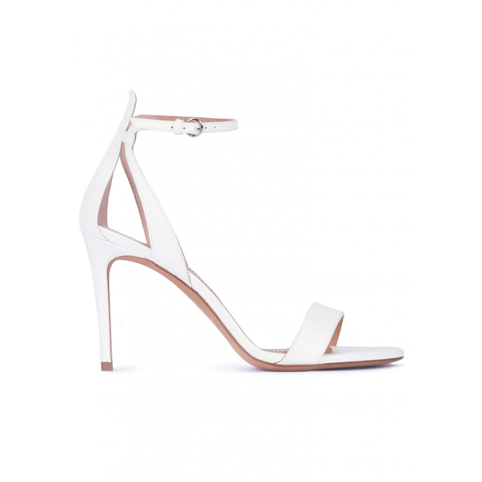 Ankle strap high heel sandals in off-white leather