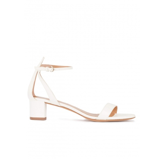 Ankle strap mid block heel sandals in offwhite leather Pura L�pez