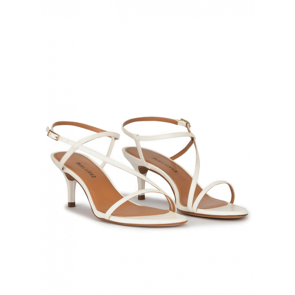 Strappy mid heeled sandals in off-white leather