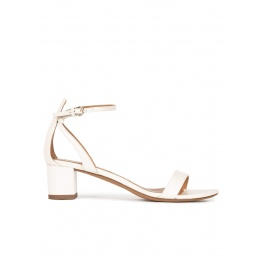 Ankle strap mid block heel sandals in offwhite leather Pura López