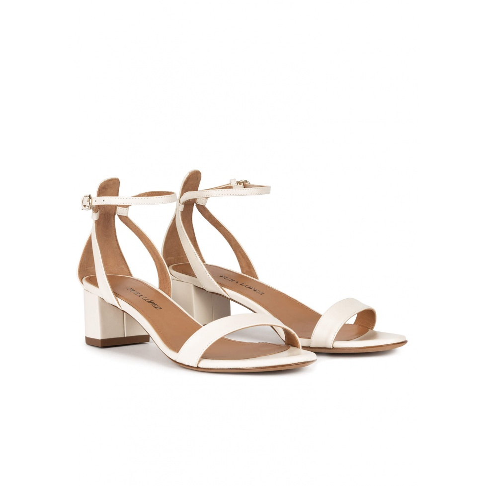 Ankle strap mid block heel sandals in offwhite leather