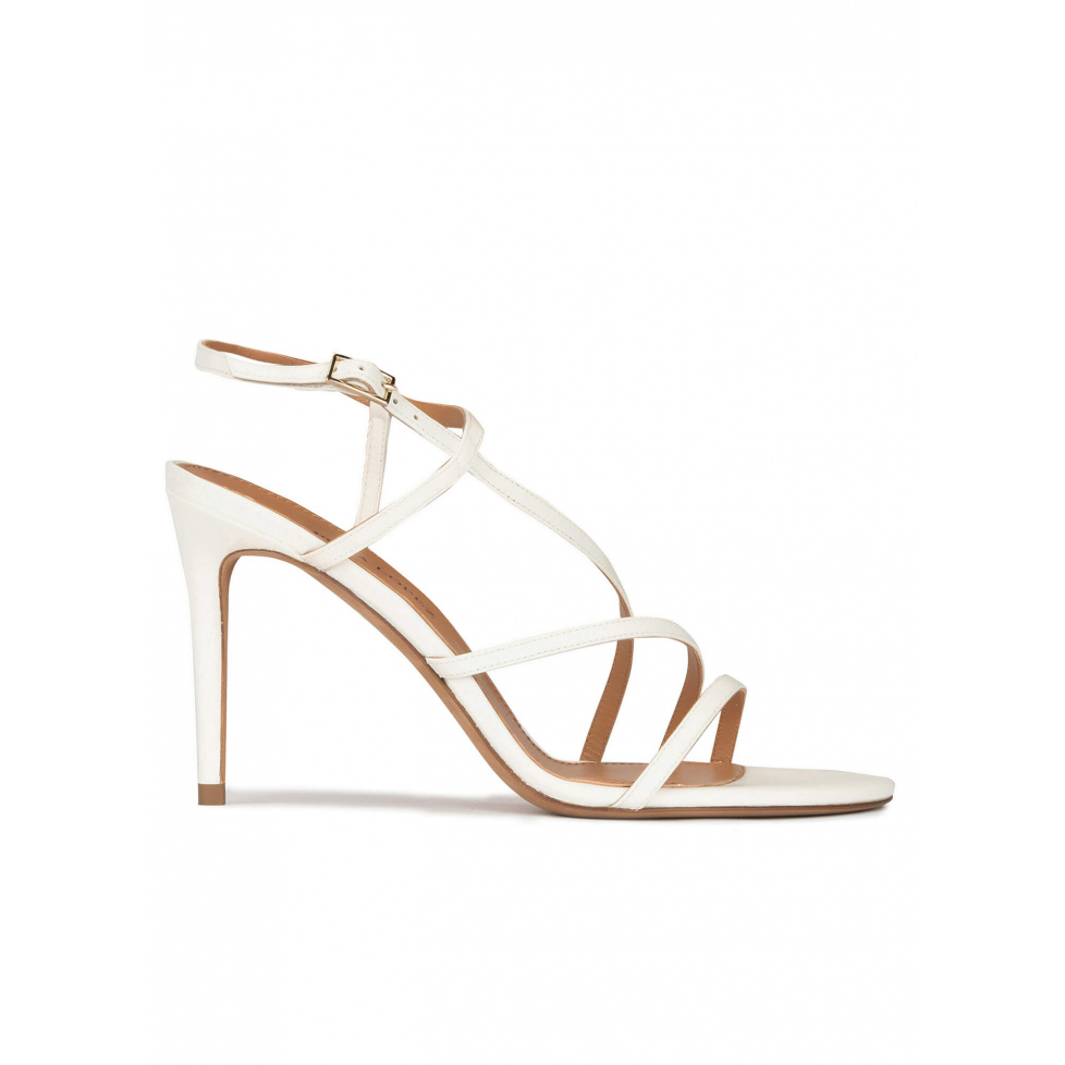 Strappy stiletto heel sandals in off-white leather