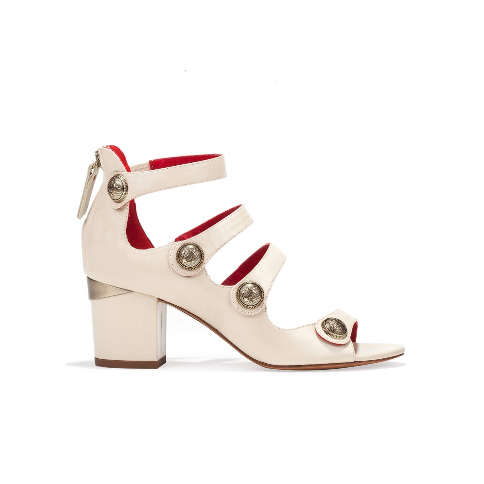 Mid block heel sandals in cream leather with metallic buttons