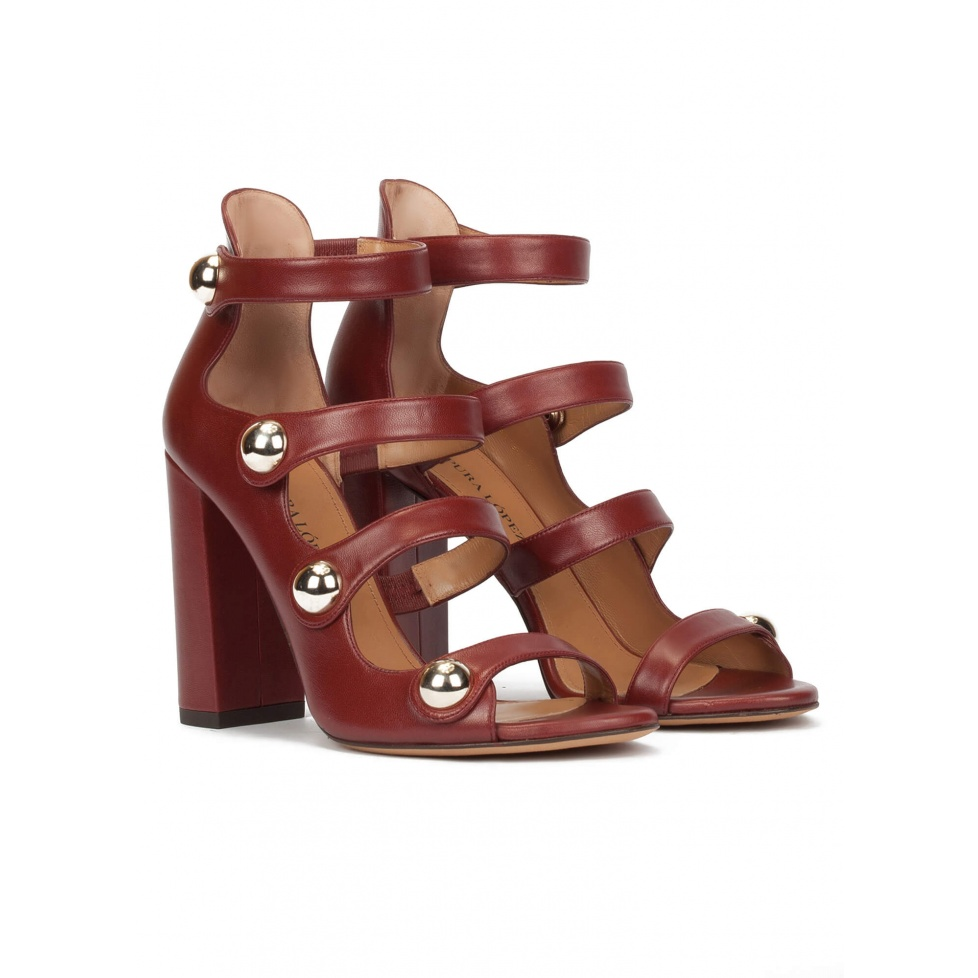 High block heel sandals in burgundy leather with buttons