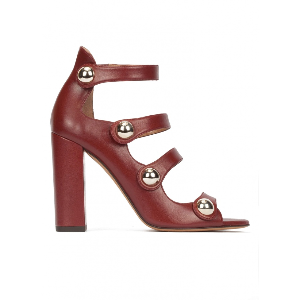 High block heel sandals in burgundy leather with golden buttons