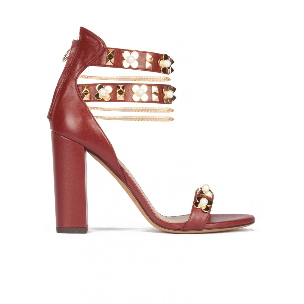 Flower trimmed ankle strap high block heel sandals in burgundy leather