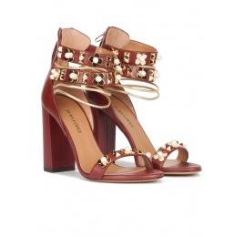 Flower trimmed ankle strap high block heel sandals in burgundy leather Pura López